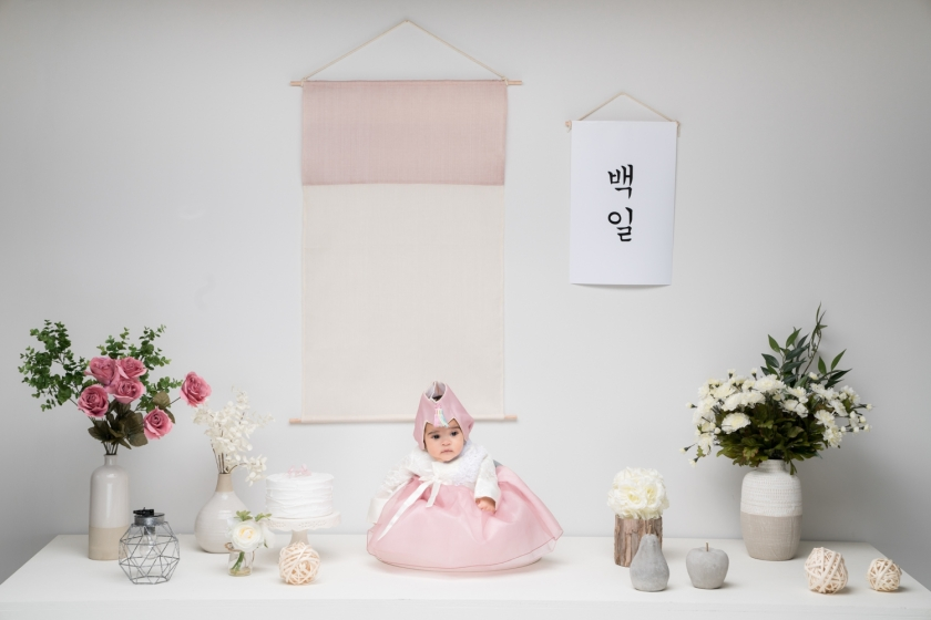 Baby girl wears traditional Korean dress for her 100 day photo shoot.