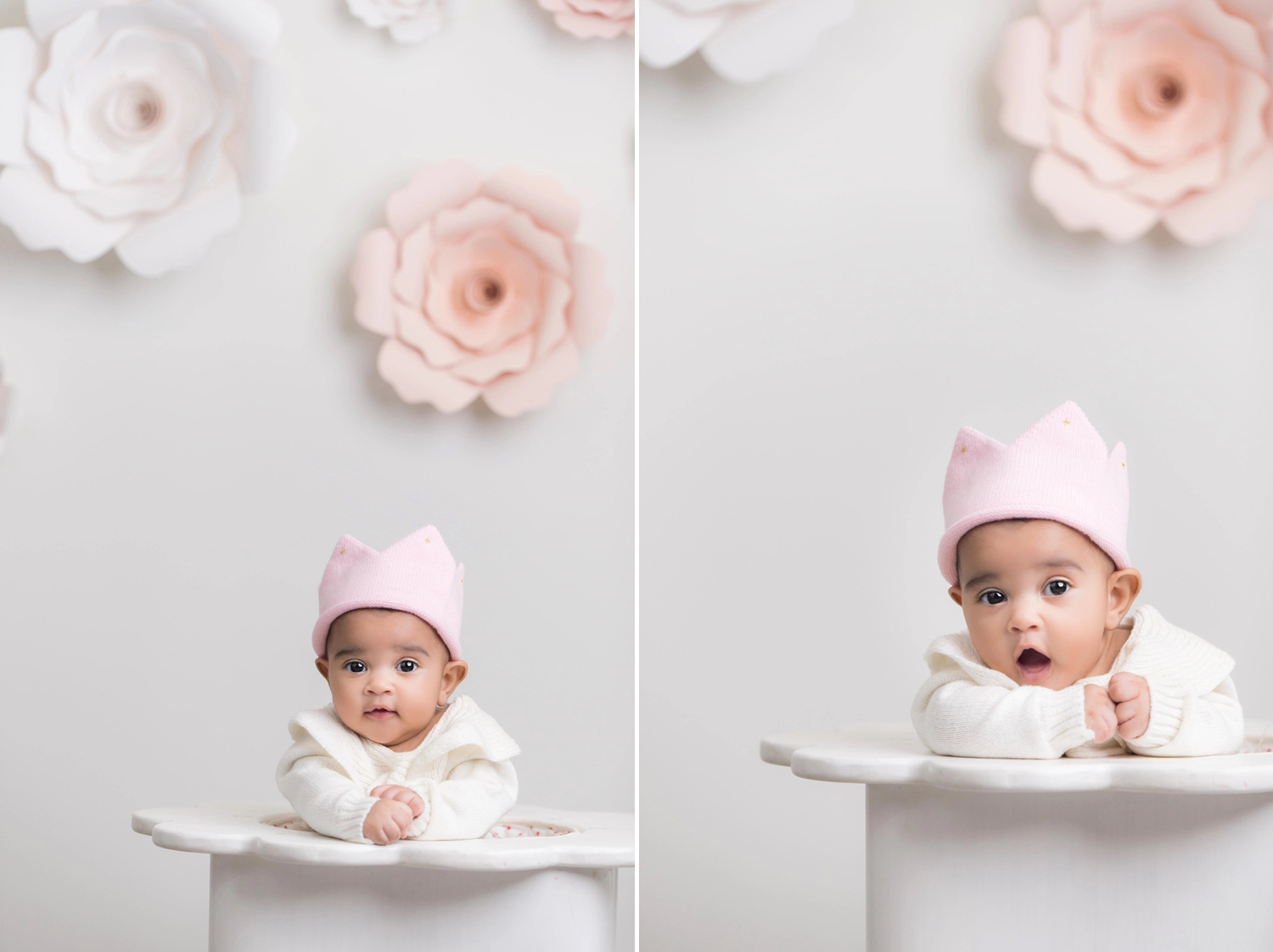 Baby girl wears a pink felt crown during traditional Korean 100-day-old photo session.