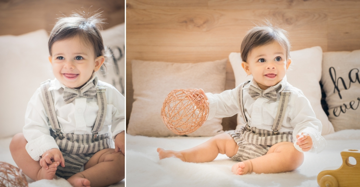 Baby boy plays with props in Chicago family photo studio.