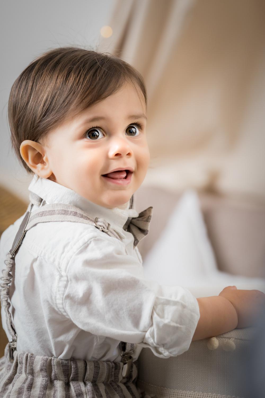 Baby boy looks back at camera.