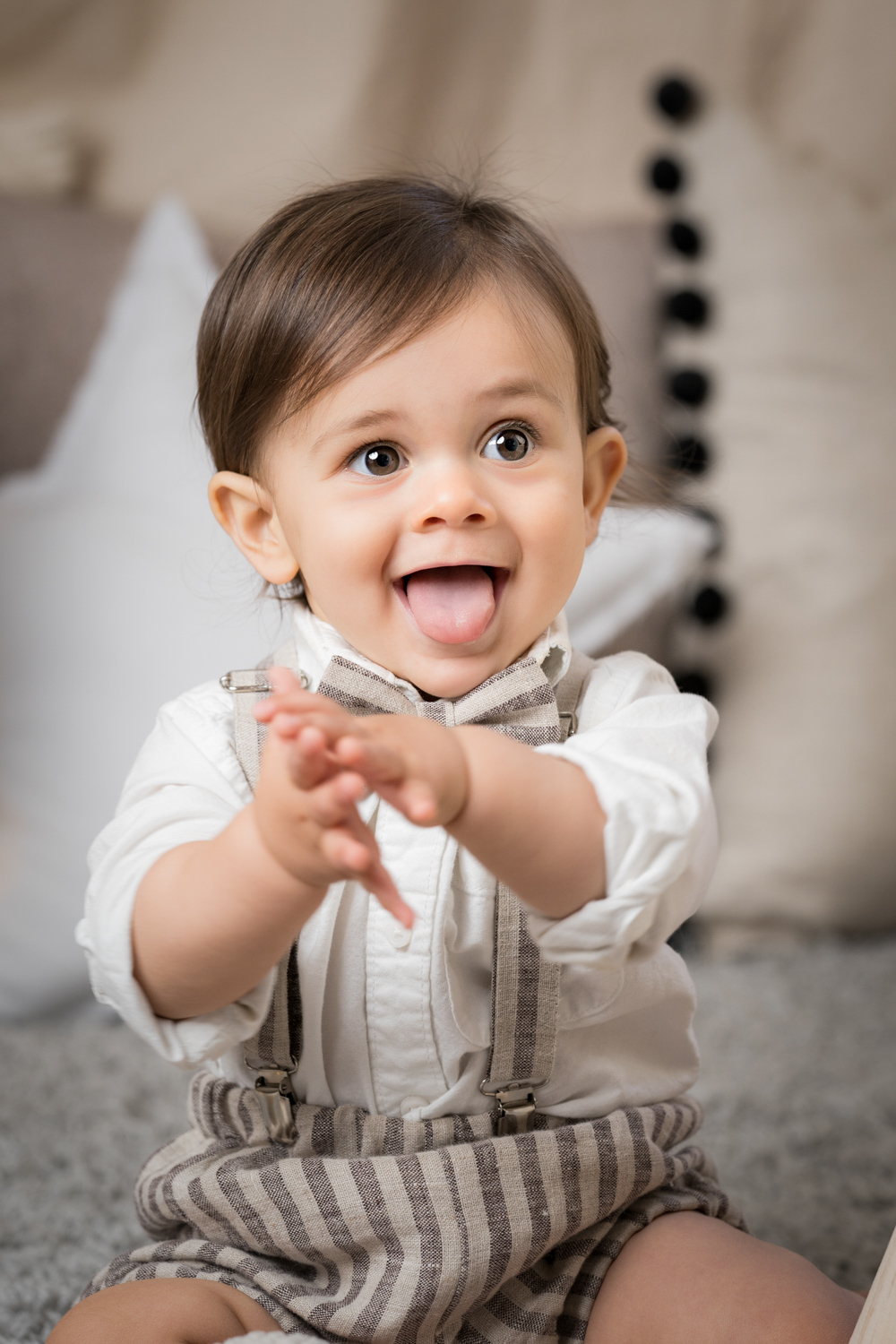 Luca smiles during a photo shoot at a Chicago family photo studio.