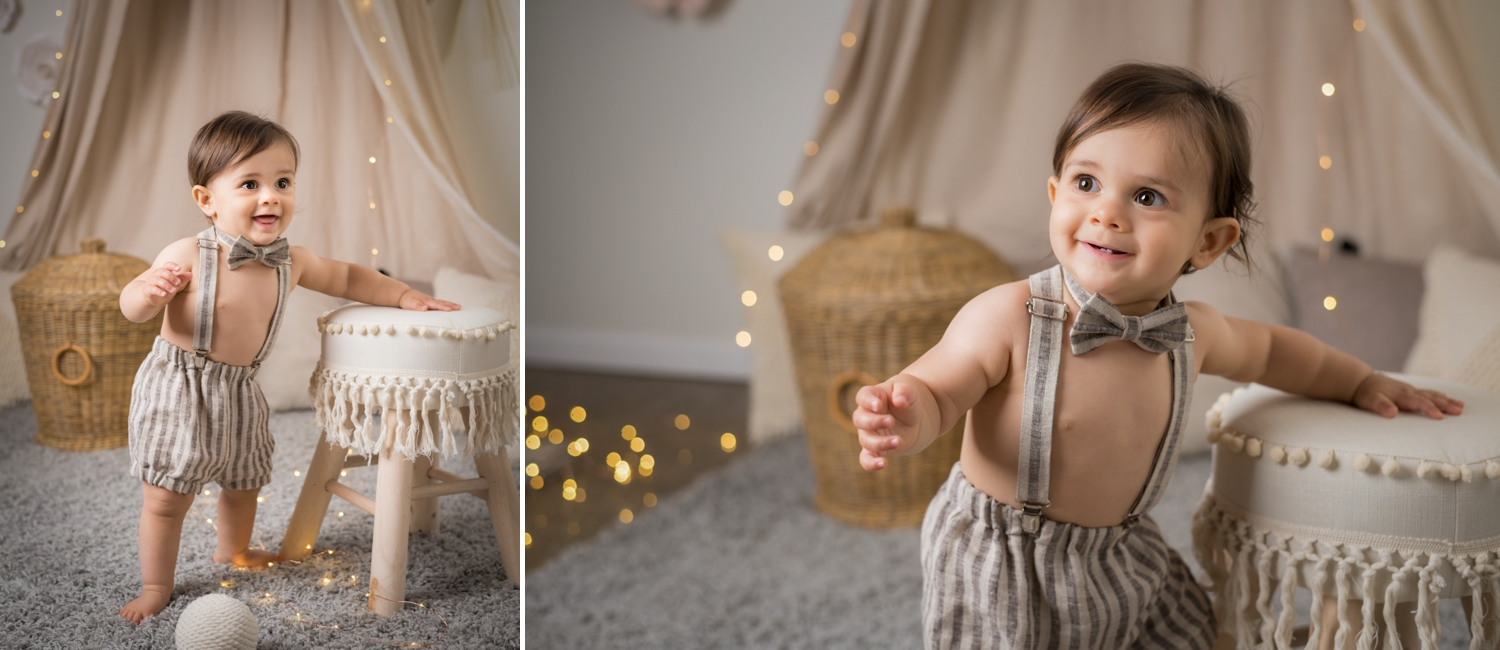 Baby boy wears suspenders and a bow tie for baby portraits.