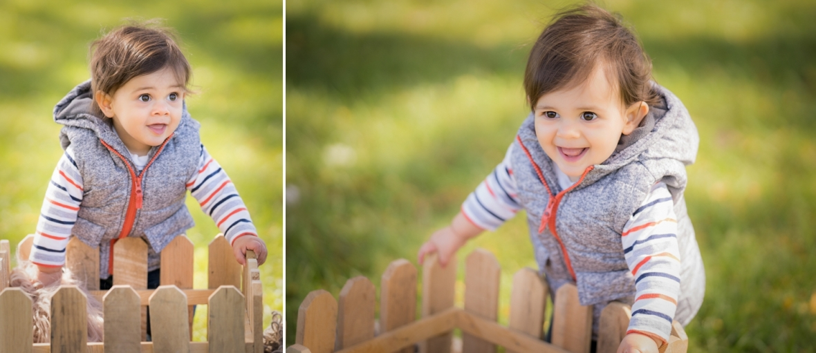 Luca smiles on the grass during a Family photoshoot by Lake Michigan.
