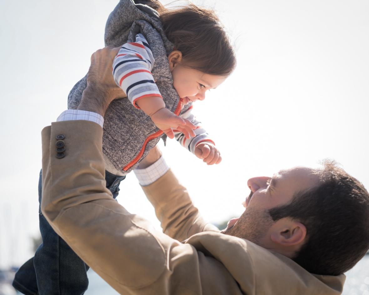 Son smiles down at dad during a Lake Michigan photoshoot.