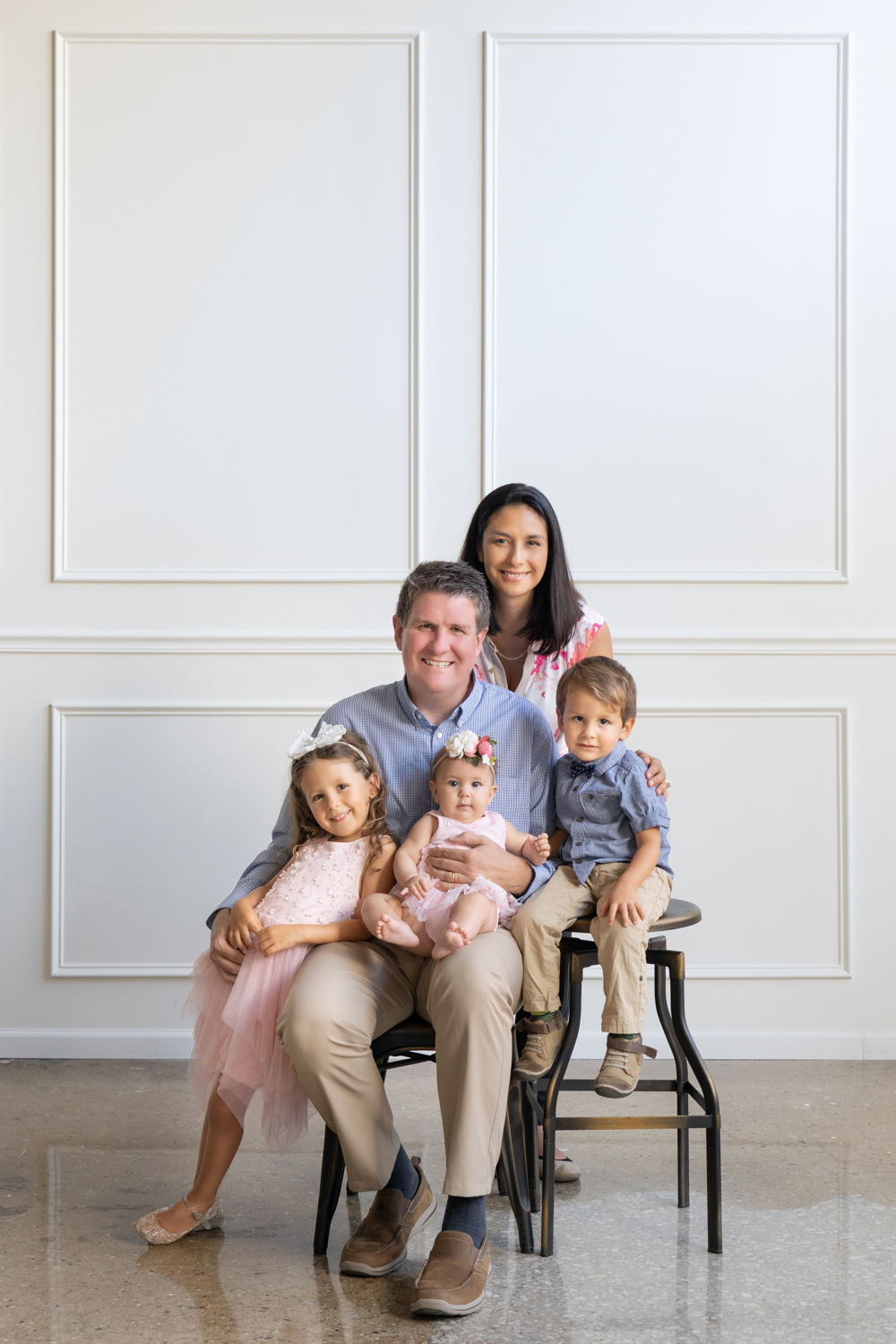 Family with three kids poses for a portrait in a Chicago photo studio.