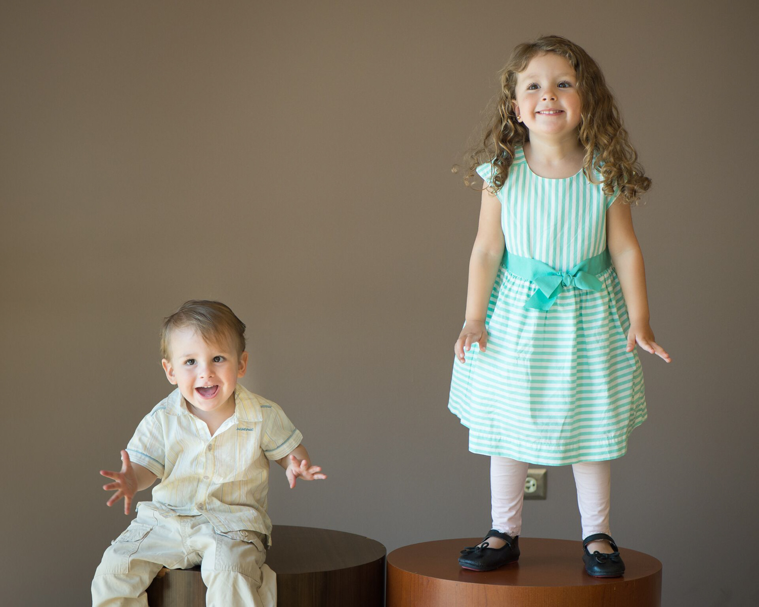 A brother and sister play during a photo shoot at a Chicago photo studio.