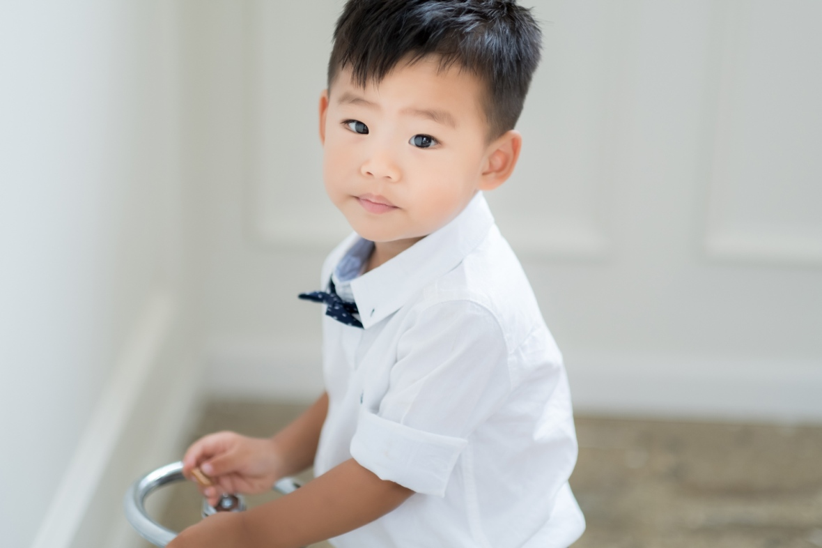 Little boy wears a bowtie during a baby photoshoot in Chicago.