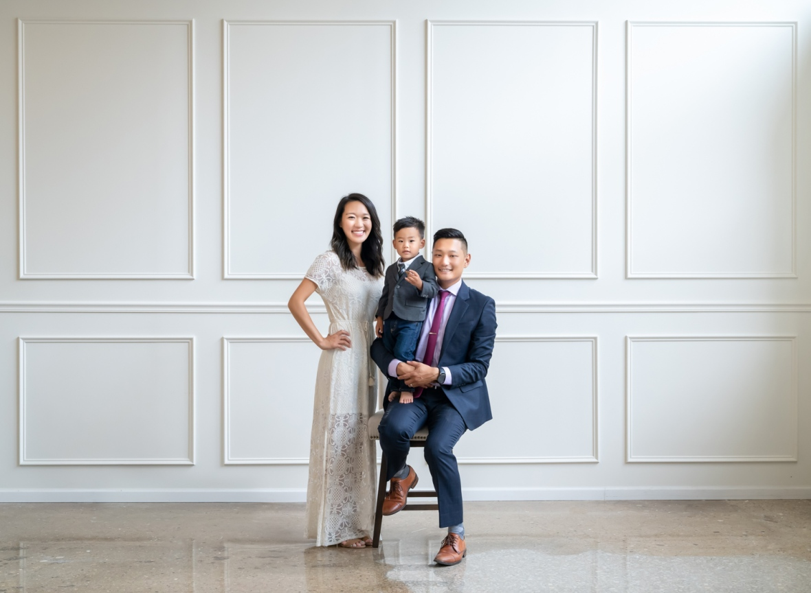 Family poses for portrait during a photoshoot at a Korean photo studio in Chicago.