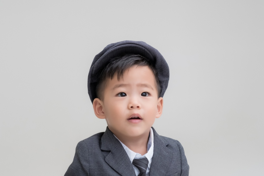 Korean boy wears suit for traditional Korean photoshoot.