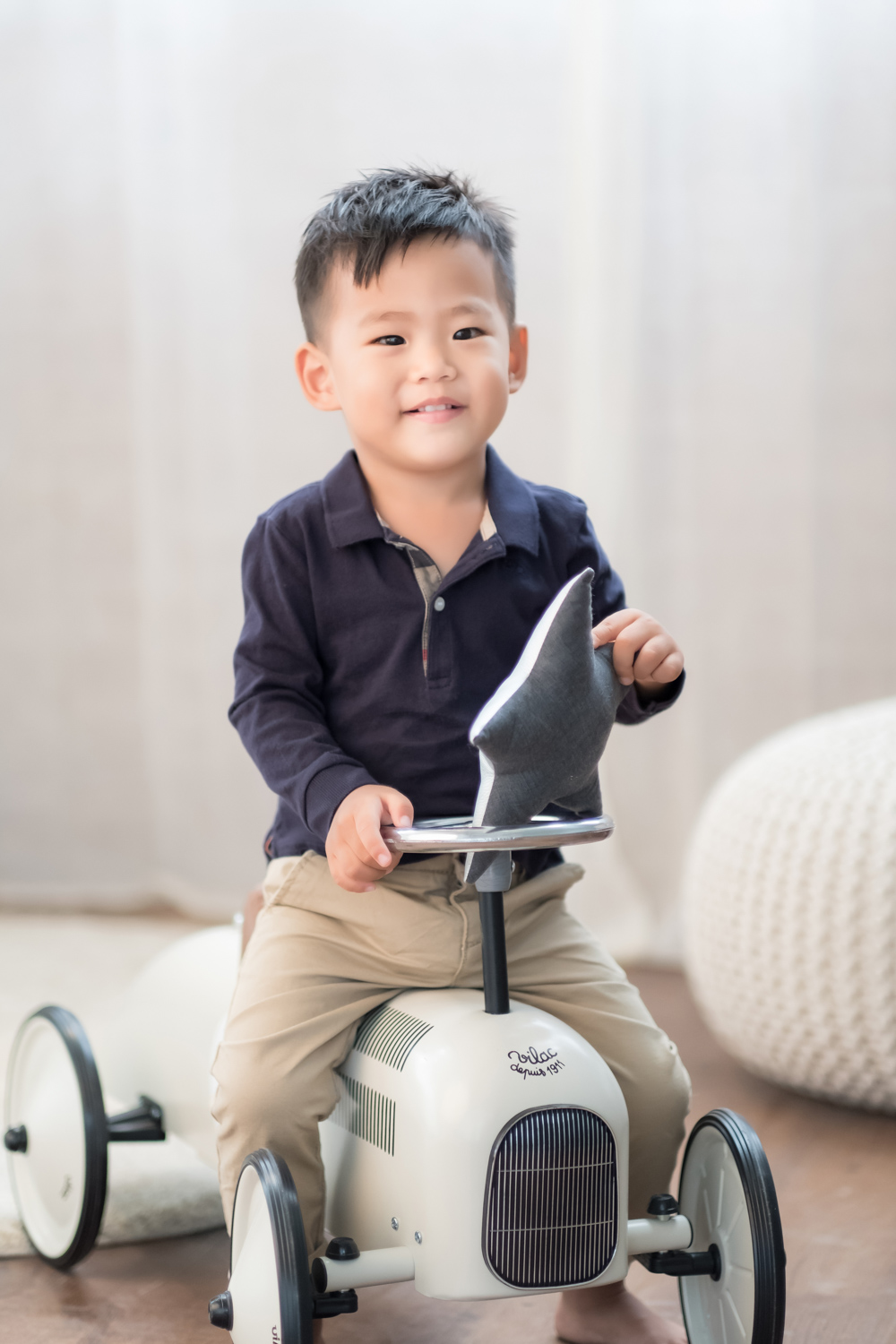 2-year-old Henry rides a retro bike in a Chicago photo studio.