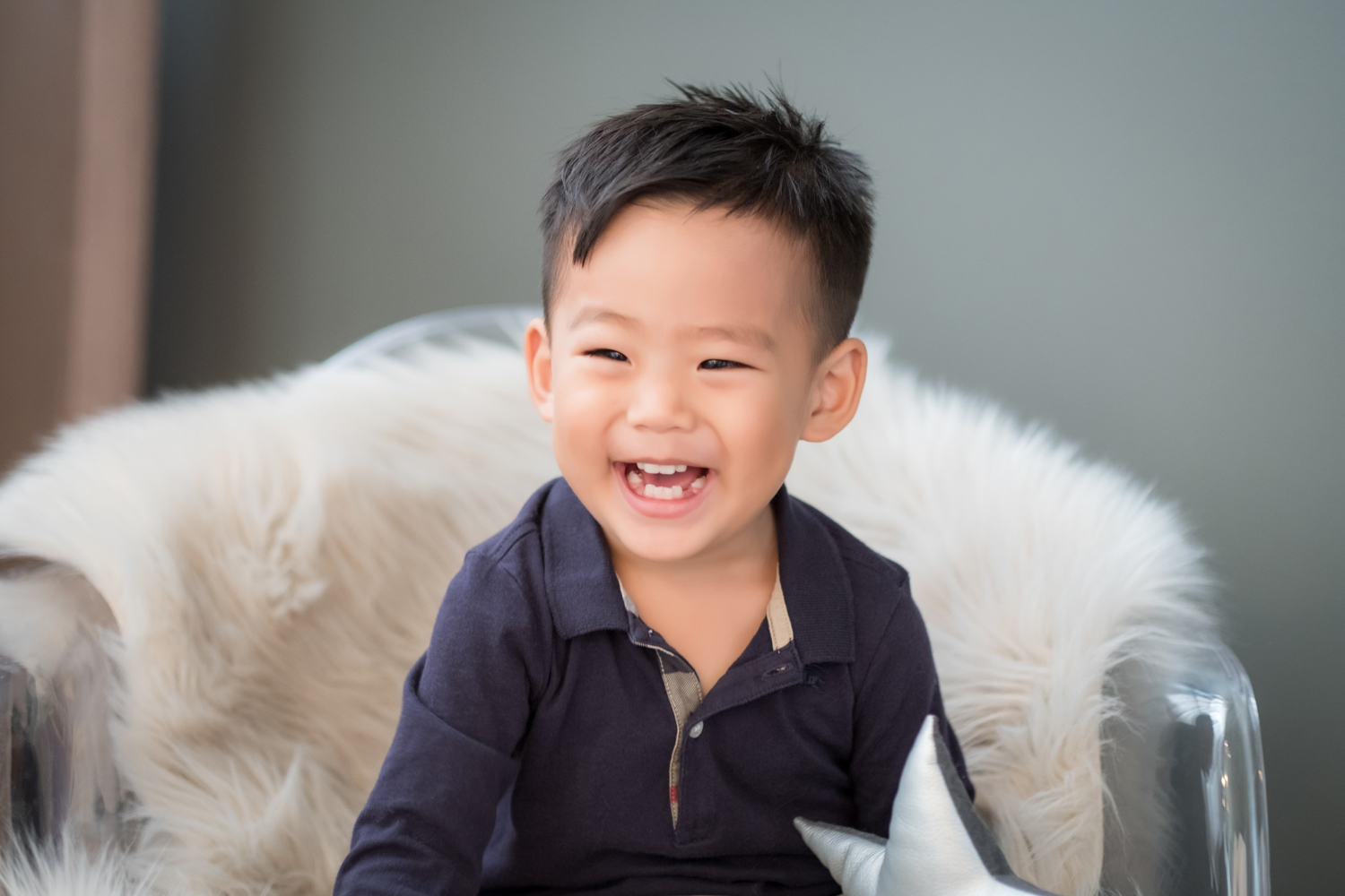 Korean toddler smiles during a family photo session.
