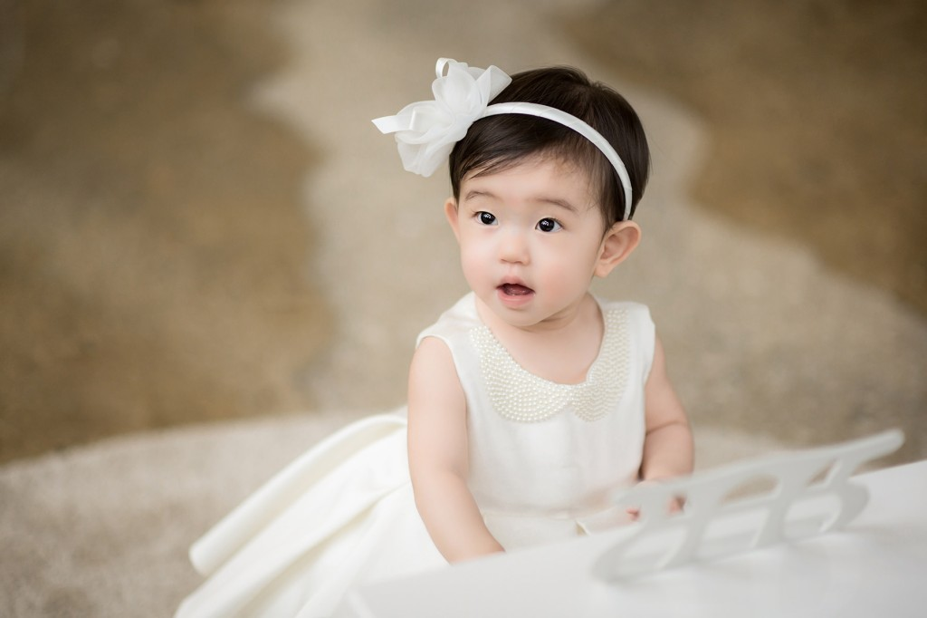 Cute Baby Girl in White Dress