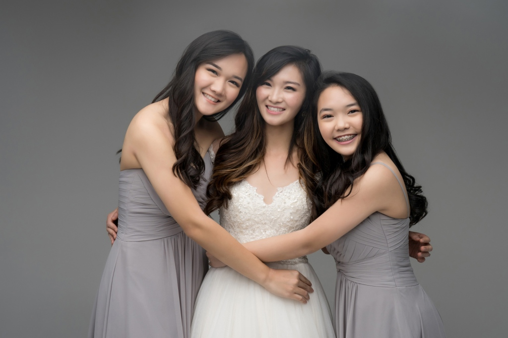 Audrey smiles with her two younger sisters.