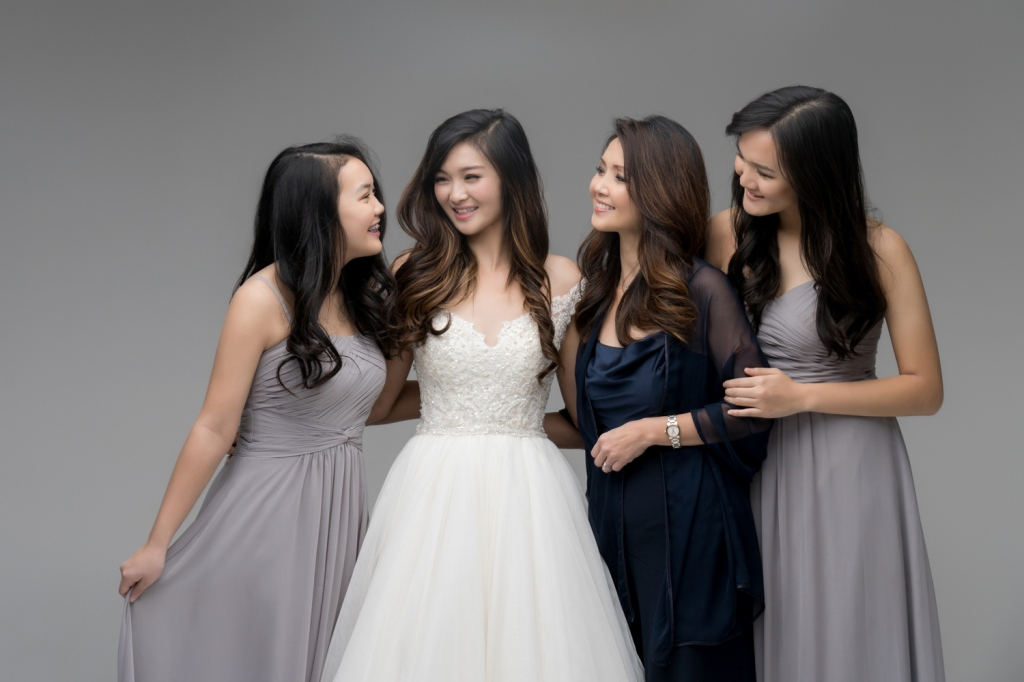 Audrey, her mom and two younger sisters share a moment during their family photoshoot.